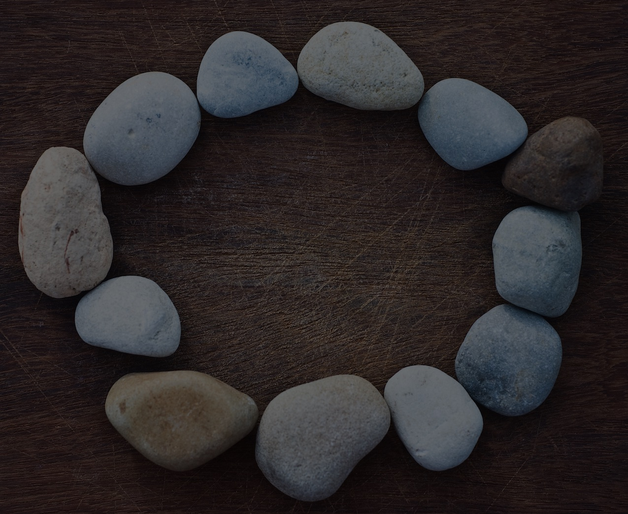 Woman Within Circle of Stones